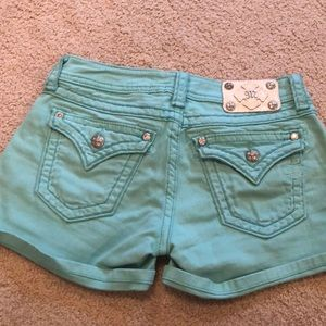 Miss me turquoise shorts.